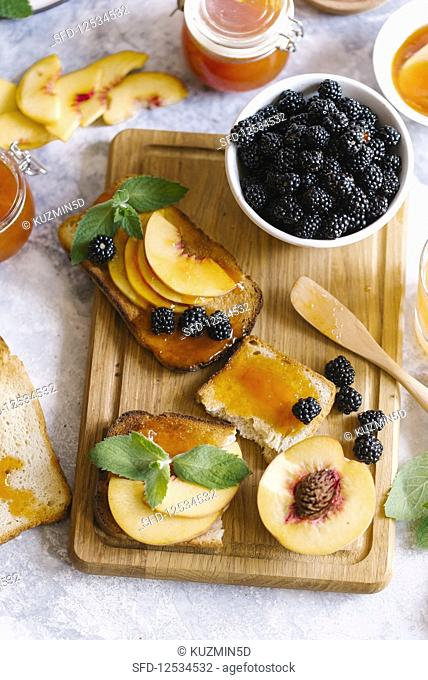 Toasts of bread with apricot jam and fresh fruits