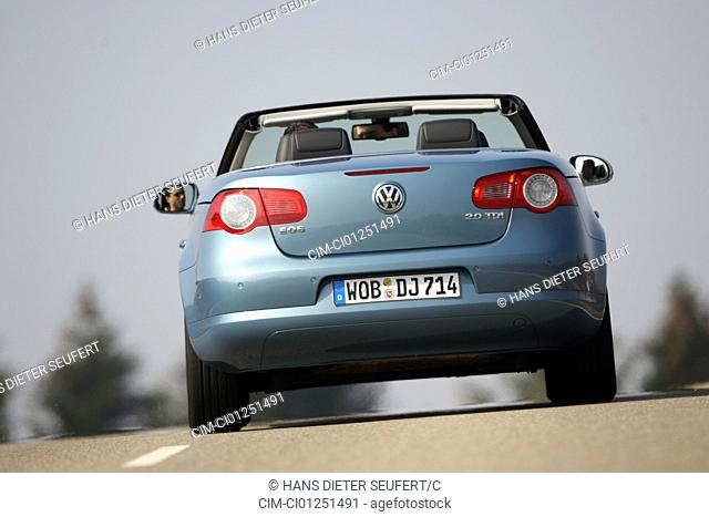 VW Volkswagen Eos 2.0 TDI, model year 2006-, hellblue moving, diagonal from the back, rear view, country road, open top