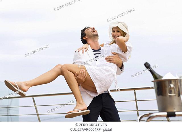 Man carrying a girl