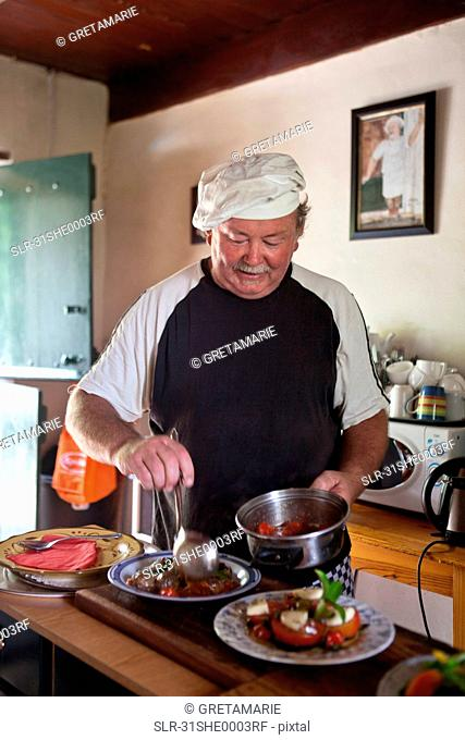 Chef arranging food