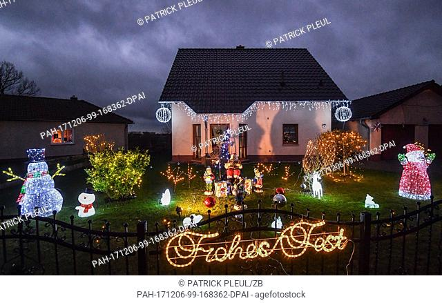 Illuminated Christmas decoration light up the dark evening hours in the front garden of a family home in Pillgram, Germany, 5 December 2017