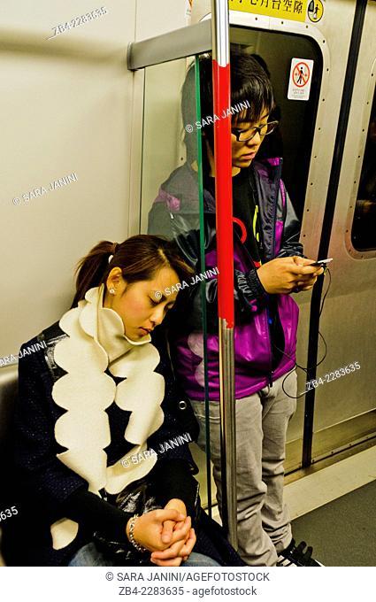 Local youngs inside the Metro, Hong Kong Island, Hong Kong, China, East Asia