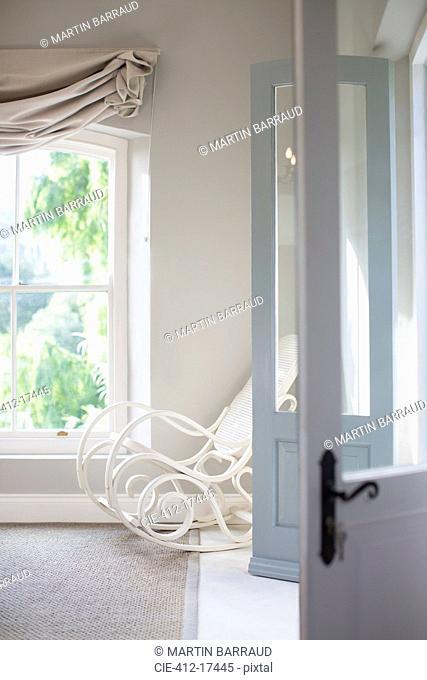 Antique rocking chair in bedroom corner