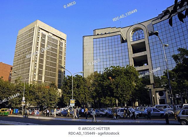 Road traffic and tower blocks New Delhi India New Dehli