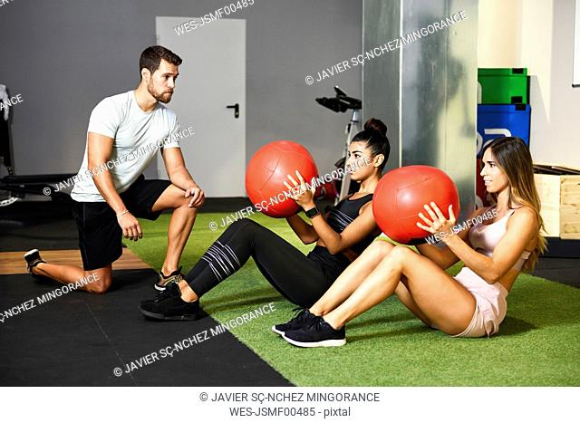Young people doing ab training with fitness balls