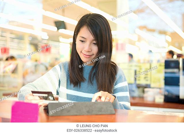 Woman using tablet pc for online shopping
