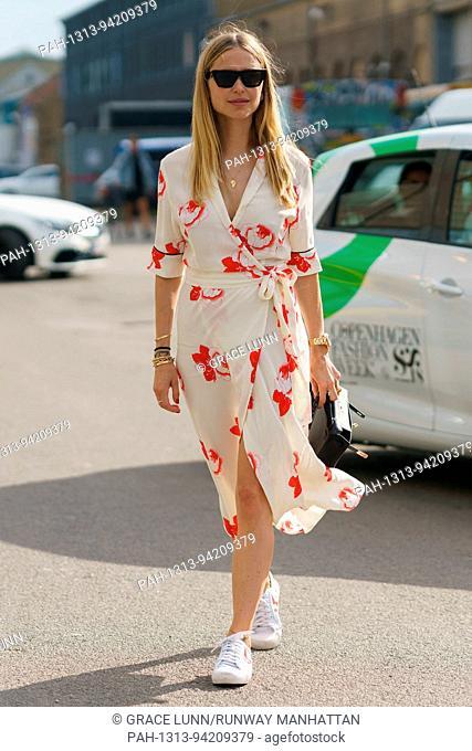 Pernille Teisbaek, Fashion Director at The You Way, posing outside the Ganni runway show during Copenhagen Fashion Week - Aug 10