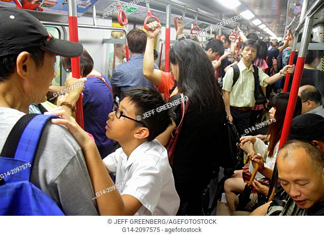 China, Hong Kong, New Territories, Sha Tin, Sha Tin MTR Subway Station, East Rail Line, public transportation, train, cabin, passengers, riders, crowded
