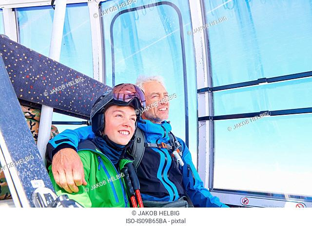 Father and son in cable car, Hintertux, Tirol, Austria