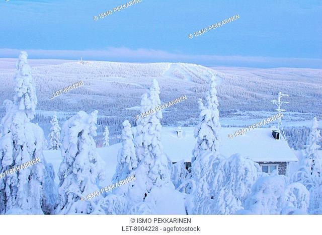 A snowy cabin. Pudasjarvi, Finland