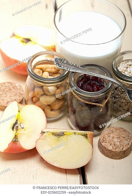 healthy breakfast ingredients milk oat cashew nuts dried cramberry craisinns