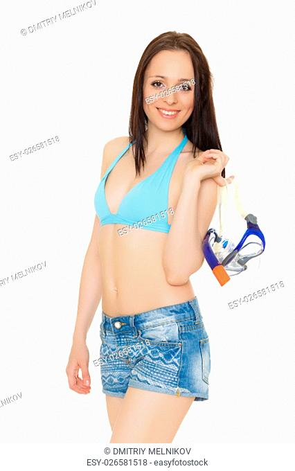 Young beautiful woman in bikini holds mask for diving standing on a white background. Vacation
