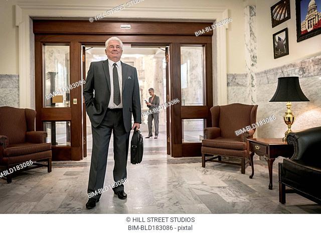 Caucasian politician standing in doorway