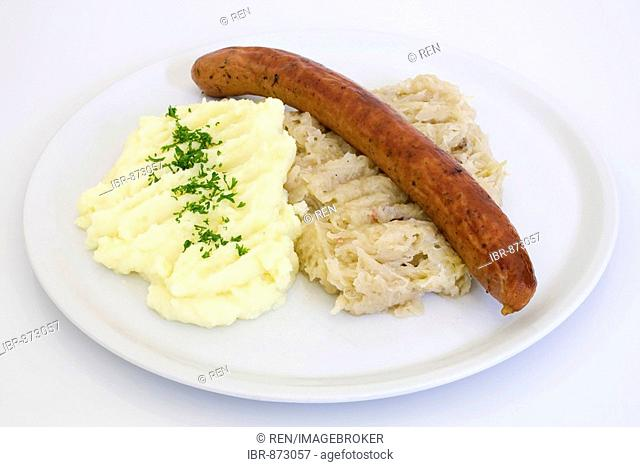 A Krakow sausage on sauerkraut, potatoe puree