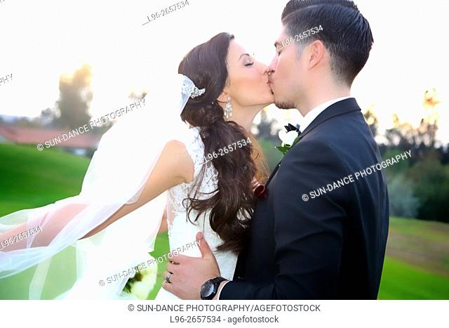 bride & groom kissing after wedding