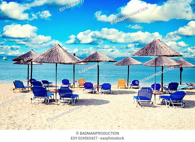 Wooden umbrellas and chairs at the beach