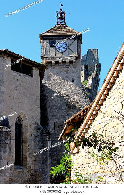 Church, stiple and clock of the church of Penne le chateau, in Tarn department, in region of Occitanie, France