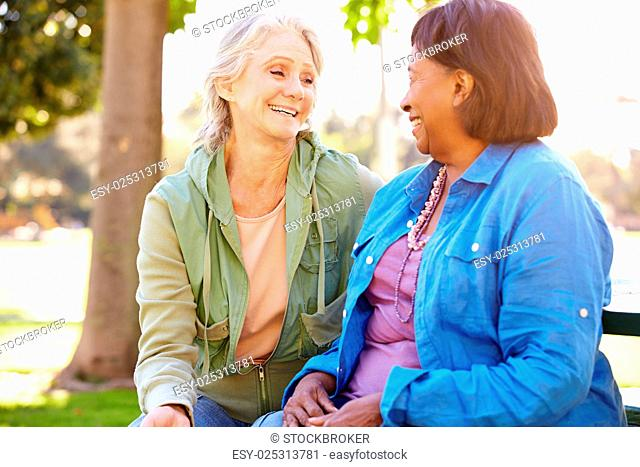 Two Senior Women Talking Outdoors Together