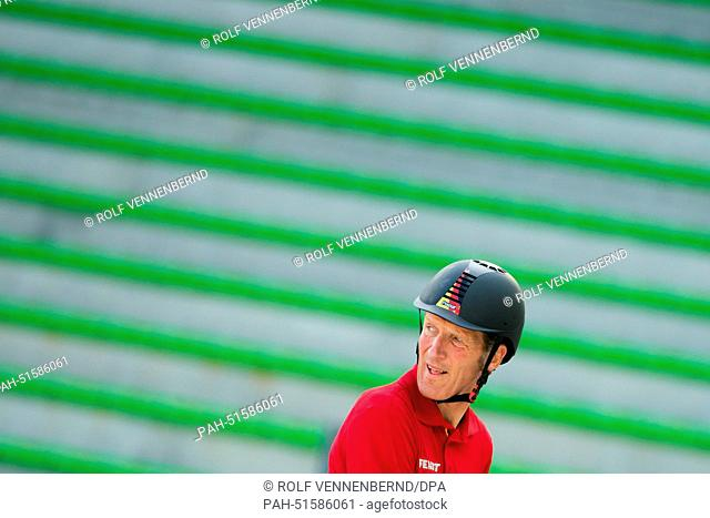 "Rider Ludger Beerbaum of Germany on horse """"Chiara 222"""" is seen during a training session for the Speed Jumping competition during the World Equestrian Games..."
