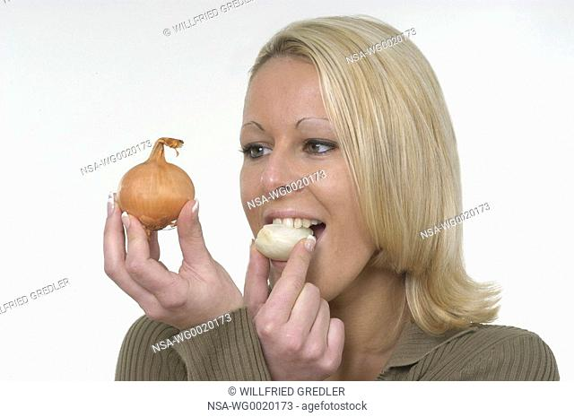 Woman bites in an onion