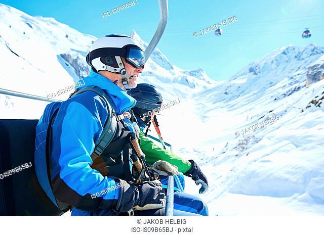 Father and son on ski lift, Hintertux, Tirol, Austria