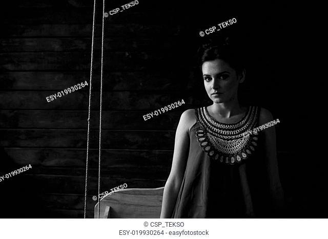 girl posing in a dark room