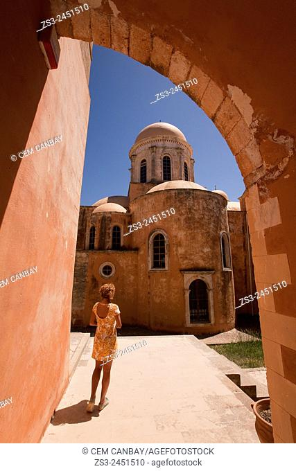 Tourist at the courtyard of the Agia Triada Monastery, Akrotiri Peninsula, Crete, Greek Islands, Greece, Europe