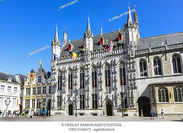 Burg Square and the city or town hall, Stadhuis city hall, Stadsbestuur Brugge, with tourists site seeing, Bruges, Belgium