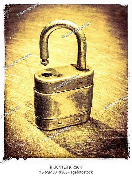 Detail photo of an opened padlock