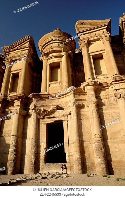 The famous and elaborately carved façade of Al Deir (the Monastery), carved out of a sandstone rock face, low-angle shot