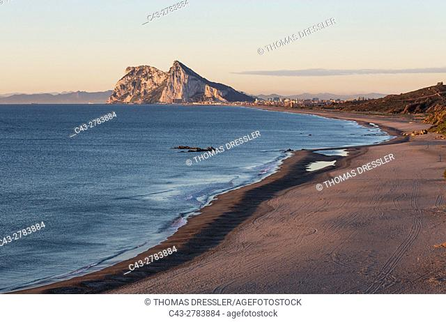 The Rock of Gibraltar (British) and the town of La Linea de la Concepcion seen from the Mediterranean coast north of it. In the background the coastline of...