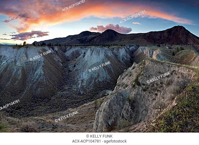 A beautiful sunset paints the ridges and valleys of the silt cliffs just east of Kamloops, Thompson Okanagan region, British Columbia, Canada