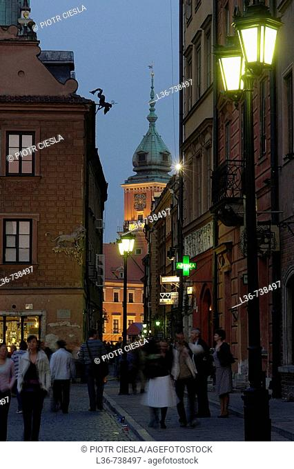 Evening in the Warsaw old town with Royal Castle in background, Poland