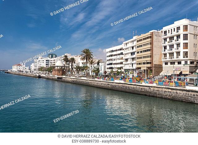 Arrecife, Spain - February 12, 2018: Arrecife cityscape, people walking in a marina promenade , Canary islands, Spain