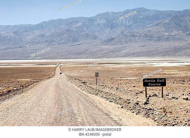 Gravel road to Devil's Golf Course, Panamint Range behind, Black Mountains, Death Valley National Park, Mojave Desert, California, USA