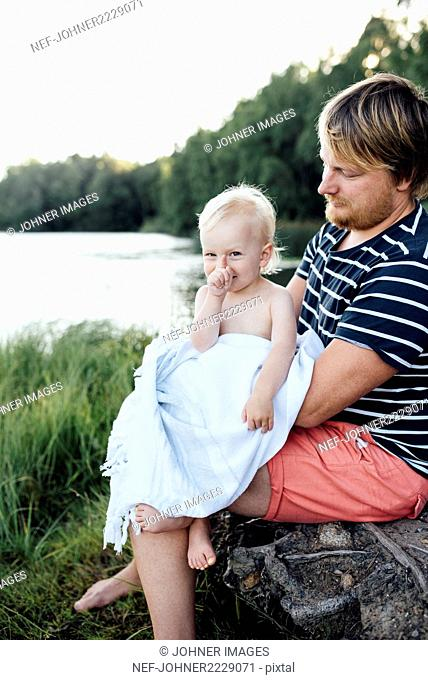 Girl sitting on fathers lap