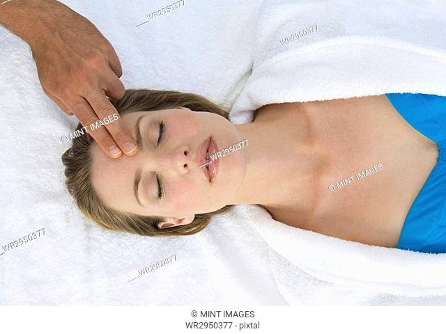 Woman receiving a head massage at a spa