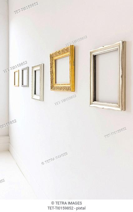 Empty picture frames in art gallery