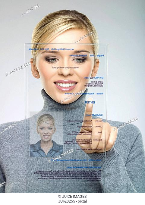 Woman using futuristic touch screen