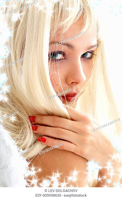 portrait of lovely blond with angel wings and snowflakes