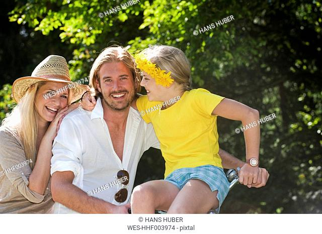 Austria, Salzburg County, Family sitting on old bicycle
