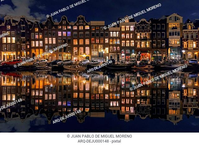 Reflection Of Houses On Canal In Amsterdam