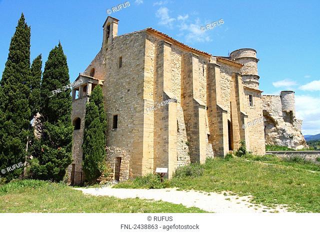 Cypress trees in front of church, Chapelle notre Dame La Brune, Vaucluse, Provence-Alpes-Cote d'Azur, France