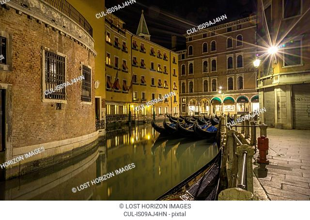 Canal and gondolas at night, Venice, Veneto, Italy
