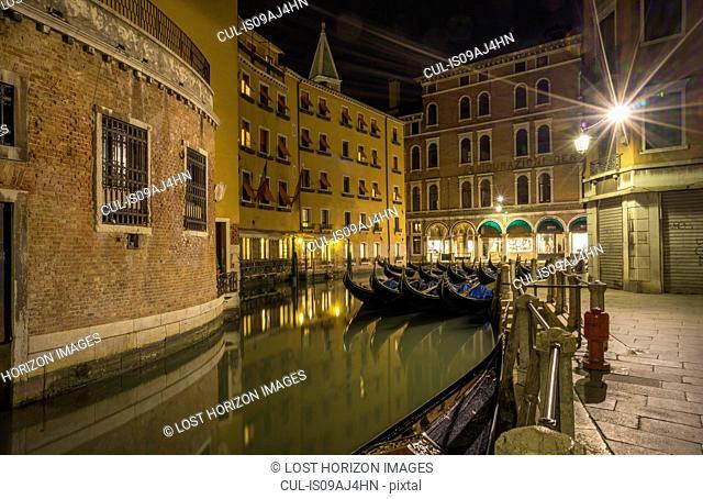 Canal and gondolas at night, Venice, Veneto, Italy