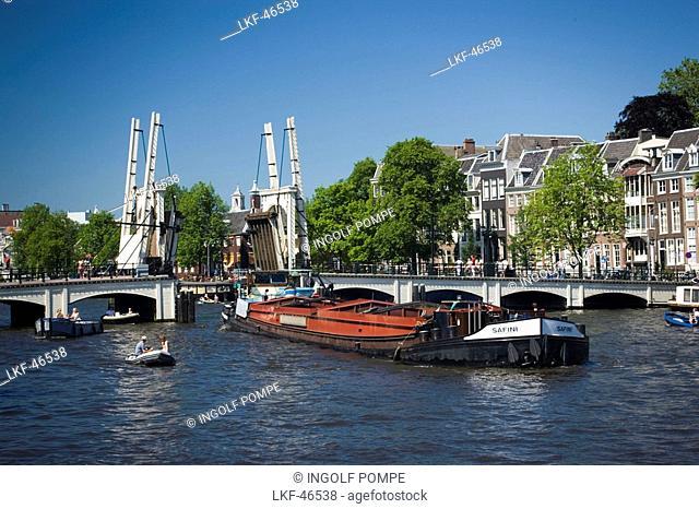 Barge, Magere Brug, Amstel, Barge passing open Magere Brug Skinny Bridge, Amsterdam, Holland, Netherlands