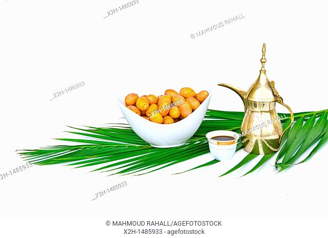 Arabic coffee pot with date fruits
