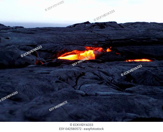 Lava flows from the earths crust and rises to the surface at Volcano's National Park on the Big Island Hawaii