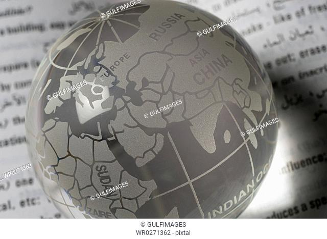 Globe over paper, close-up