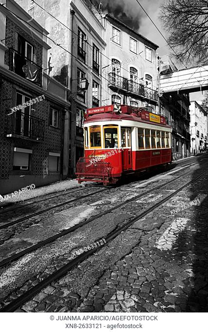 Photograph in black and white mixed with colour of Red Tram in Lisbon, Portugal, Europe